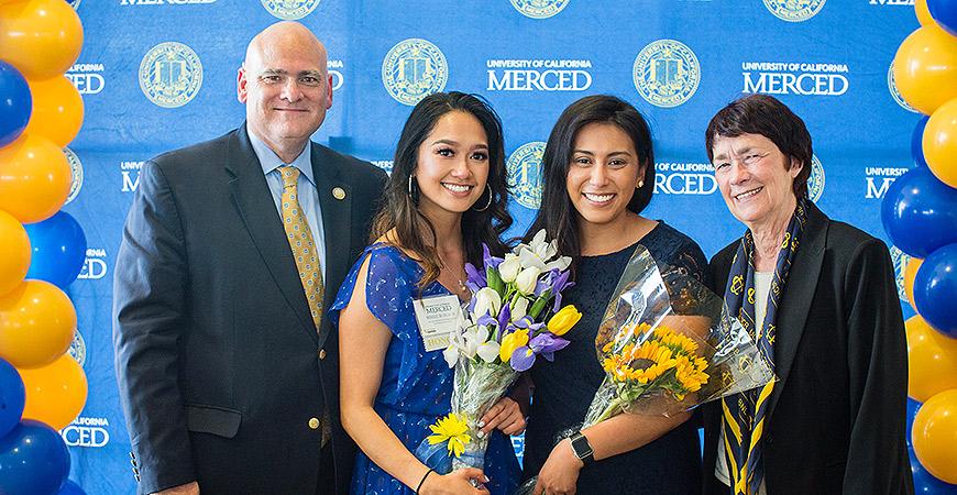 Vice Chancellor Ed Klotzbier, Monique de Villa ('16), Danielle Armedilla ('12), and Chancellor Dorothy Leland