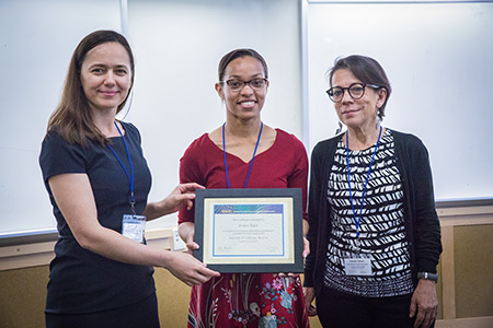 Professor Noemi Petra, left, and Professor Daniella Calvetti, right, present SIAM President Jessica Taylor, center, with a certificate of recognition.
