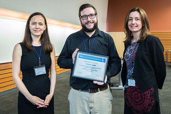 Michael Stobb receives an award.