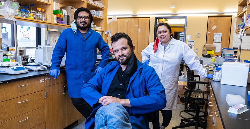 Professor Shahar Sukenik, center, with graduate students Eduardo Flores and Karina Guadalupe, investigate intrinsically disordered proteins.